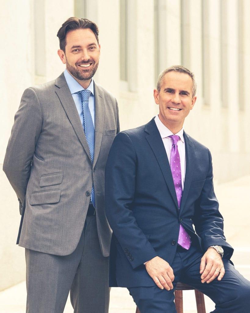 Photo of Jonathan Conlon and John Gasdaska on the Meet the Gasdaska Conlon Team page